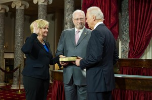 Senator Claire McCaskill takes the oath of office Jan. 3 administered by Vice President Joe Biden and observed by her husband Joe Shepard.
