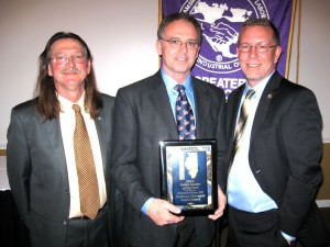 David Beard, business manager for Ironworkers Local 392, center, was named Labor Leader of the Year on March 28 at the Greater Madison County Federation of Labor's 24th annual awards banquet at Julia's Banquet Center in East Alton. From left are the presenter, Rick Stamer, Beard and B. Dean Webb, president of the Federation. Beard has been active in the labor movement since he was 18 years old. He and his family live in Waterloo.