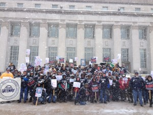 PROTESTING FOR AMERICANS in the worst snow storm in decades, postal workers, religious leaders and volunteers gathered at the main St. Louis post office downtown to protest the ending of Saturday delivery as a cost-cutting effort.