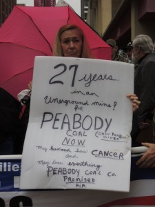 LaVERNE REHBEIN, the wife of a retire Peabody mineworker, holds a sign explaining her husband's plight and what is at risk in the bankruptcy proceedings of Peabody spinoff Patriot Coal. – Labor Tribune photo