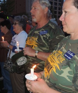 RETIRED MINER Fred Wagner (center) and his wife Margie, of Steeleville, IL, at a candlelight vigil April 29 outside the federal courthouse where Patriot Coal's bankruptcy case is being heard. Labor Tribune photo