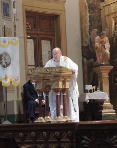 FATHER RICHARD H. CREASON delivering his homily at the Robert O. Kortkamp Memorial Union Labor Mass, May 5 Labor Tribune photo