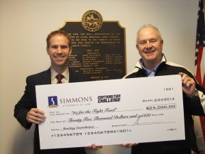 $25,000 MORE FOR 'FIGHT FUND' is the pledge of the Simmons Law Firm as they announced their second $25,000 Challenge Grante to help out-of-work families. Simons attorney Chris Guinn (left) presented the Contribution Challenge draft check to St. Louis Labor Council President Bob Soutier. Labor Tribune photo