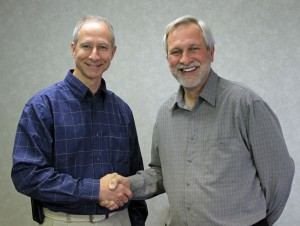 PASSING THE BRUSH: International Union of Painters and Allied Trades District 2's new Director of Training Tim Bernstetter (left) wishes outgoing director Tim Klotz (right) well on his retirement. Gary Otten photo