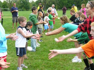 FAMILY FUN FOR EVERYONE at the Sept. 28 Gala Labor Family Picnic and Tug-O-War in Forest Park. Games for the kids will include (above) an Egg Toss (watch their faces when there's a miss!), age appropriate tug-of-war (with prizes for everyone) and face painting and balloon sculptures… and much, much more. There's games for adults too, and lots of good picnic eats. Funds raised will go to help out-of-work families served by the $5 for the Fight Fund.
