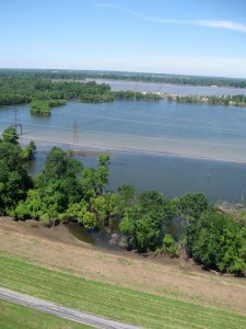 A LEVEE TOPPED by a bike trail, foreground, protects central Madison County from Mississippi River floodwater after recent rains.
