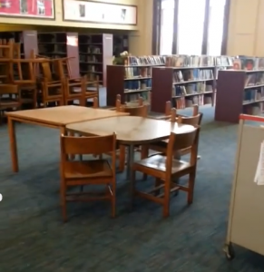 LEAD LADEN DUST in both Sumner and Roosevelt high schools where lead paint removal by two non-union contractors covers desks, chairs, equipment and yes, even open book shelves. No effort is made to protect the equipment with plastic sheets. Painters District Council 2 photo
