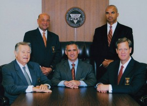 NOT BEING RESPONSIVE to St. Louis County police officers, members of the Police Board took a year to finally recognize the St. Louis County Police Officers Association. Commissioners are (seated from left) Vice Chairman Floyd Warmann, Chairman Greg Sansone and Secretary Ray Wagner. (Standing from left), John Saracino and Roland Covington. – St. Louis County photo