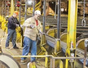 UP FOR SALE? Workers inside the Alton Steel plant. Union members are wary about what the possible sale of the plant could mean. Alton Telegraph photo