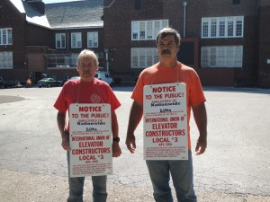 North St. Louis – Brian Spilker (left) and Jim Piwowarczyk, of Elevators Constructors Local 3, picketing last week outside of Ashland Elementary School on Newstead Ave. The Elevator Constructors are trying to draw attention to general contractor Demien Construction's use of an out-of-state non-union subcontractor. Nationwide Lifts of Wisconsin who is installing these handicapped accessible elevators at Ashland and eight other schools in the district pays below area standard wages and benefits established by Local 3. Labor Tribune photo