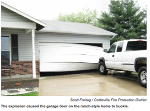 ONE HELLAVA EXPLOSION: The basement explosion at the St. Peters home where Huddy Painting was painting the basement floor was so strong it also buckled the garage door on the ranch-style home. Cottleville Fire Protection District photo from screen capture