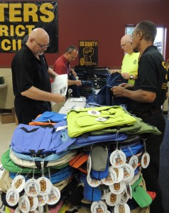 More than 40 volunteers turned out at the International Union of Painters and Allied Trades (IUPAT) District 2 hall in St. Louis to stuff 659 backpacks with school supplies for kindergarten through sixth grade students at Ashland and Hickey elementary schools.