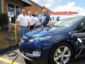 POWERING UP at the Electrical Industry Training Center's new car charging station are Bob Unterreiner, president of Schneider Electric – which installed the car charger – training center Director Dennis Gralike, Schneider Electric Vice President Mike Picker and IBEW Local 1 Business Manager Frank Jacobs. Labor Tribune photo