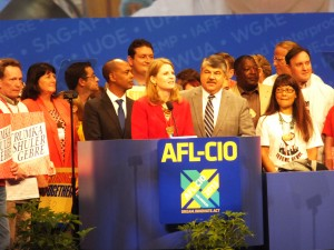 Los Angeles -  ACCEPTING THE UNANIMOUS ELECTION by the delegates at the AFL-CIO Convention were the AFL-CIO's top executive officers (from right to left) President Richard Trumka, Secretary-Treasurer Liz Shuler and Executive Vice President Tefere Gebre surrounded by friends, family and staff as they thanked the delegates for their willingness to step forward and fight for the survival of America's Middle Class. Labor Tribune photo