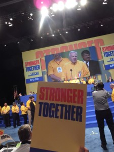 """Los Angeles - 'STRONGER TOGETHER' was the way UFCW President Joe Hansen (on giant screen behind the podium) explained to the AFL-CIO Convention delegates why the 1.3 million strong union opted to come back into the AFL-CIO. """"We are a stronger for improving members' contracts, living standards and benefits when we work together,"""" he said to the wild applause of the almost 1,000 delegates and visitors attending the three-day national meeting of unions from across America. – Labor Tribune photo"""