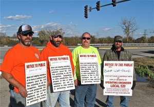 TAKING IT TO THE STREET: Union laborers and operating engineers picketed at the intersection of Illinois Route 143 and Cpl. Belchik Memorial Expressway, by the Mississippi River as part of a campaign to convince the U.S. Army Corps of Engineers to use a project labor agreement as part of a multi-million project to improve levees protecting the Metro-East from river flooding. Taking the message to the street were (from left) Laborers 218 member Bill Sloan, Laborers Local 338 members Colin Overmeyer and Greg Scott and Operating Engineers Local 520 member Bilejo Henson. –Labor Tribune photo