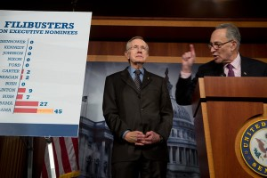 HOW OFTEN FILIBUSTERS HAVE BEEN USED? Sen. Charles E. Schumer (D-NY)(right) with Sen. Majority Leader Harry Reid (D-NV)(center) show how filibusters have spiked under the Republican Senate minority in recent years, with an increasing number being used against high-level presidential nominees. Last week, the Democratic-led Senate voted to remove the option for such nominees to break the blockade of President Obama's cabinet and federal judiciary picks. – Stephen Crowley, New York Times photo