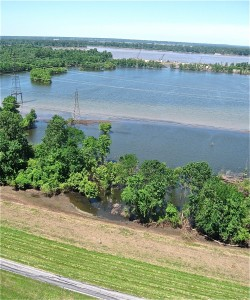 THE LEVEE, in the foreground, holds back floodwater on the Mississippi River, south of Wood River.