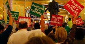"ILLINOIS WORKERS PROTEST proposed pensions cuts calling them ""pension theft."" – In These Times photo"