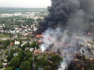 TRAIN TRAGEDY: Fire raged in the town of Lac-Mégantic, Quebec after rail tankers carrying crude oil escaped the tracks. A U.S. House Bill (HR 3040), called the Safe Freight Act and backed by the United Transportation Union, would address safety rules by requiring two-man crews on freight trains. – Sûreté du Québec photo