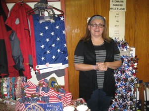 MADE IN AMERICA: Kim Roth, co-author of Take Back America: 20 Simple Ways the Average American Can Help, displays some of the American-made products she says purchasing can help create jobs. – Labor Tribune photo