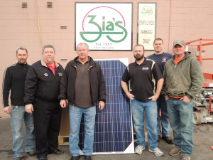 GOING SOLAR: IBEW Local 1 signatory contractor AVCO Electrical Services recently installed a 66-panel solar array at Zia's on the Hill at 5256 Wilson Ave.  Displaying one of the panels outside the restaurant are (from left) AVCO electrician Chris Tominia, Local 1 Business Representative Rob Dussold, Zia's owner Dennis Chiodini, AVCO owner Alan Van Alstine, and AVCO electricians Brian Schmalzer and Andrew Van Alstine. – Labor Tribune photo