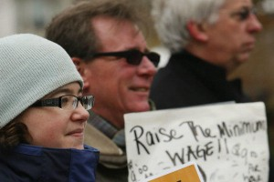 Jennifer Diagostino, executive director of the Coalition for Economic Justice, CWA Local 1122 Vice President  John Mudie, (center) and President Jim Wagner (right) participate in a rally in Buffalo, N.Y., to call for a raise in the state's minimum wage.  – Derek Gee/The Buffalo News/AP photo
