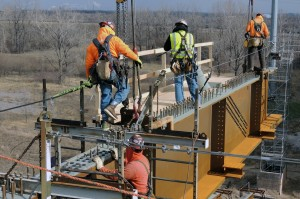 IRONWORKERS FROM LOCALS 392 AND 396 working on the Stan Musial Veterans Memorial Bridge.