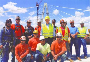 UNION IRONWORKERS from Locals 392 (East St. Louis) and 396 (St. Louis) with Missouri Gov. Jay Nixon (center) marking completion of the main span of the Stan Musial Veterans Memorial Bridge. – The Ironworker photos