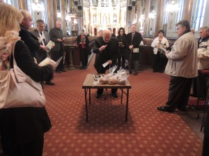 REMEMBERING WORKERS who lost their lives, Father Richard H. Creason (center) leads a memorial ceremony inside the Shrine of St. Joseph prior to last year's Robert O. Kortkamp Memorial Union Labor Mass. –Labor Tribune file photo
