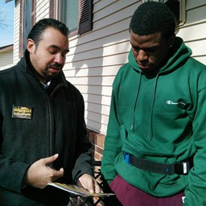NEXT WAVER Orlando Rivera, Jr. (left) , of Local 371, DC 37, with home care attendant Kevon Short. – AFSCME photo