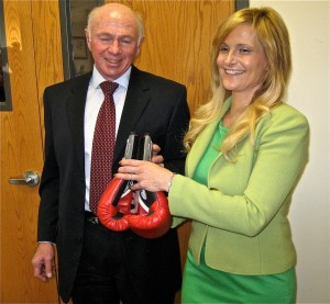 A HARD FIGHT AHEAD: Ann Callis, Democratic candidate for Illinois 13th District Congressional race, receives red boxing gloves from National Committee to Preserve Social Security and Medicare PresidentMax Richtman at the Wood River Moose Lodge where she spoke recently with AFCSME retirees. Labor Tribune photo