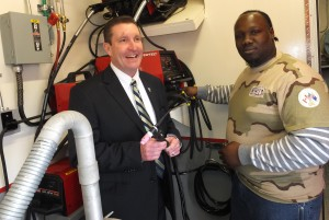 IN TRAINING, Iraq war vet Markus Collier (right) talks about the welding equipment on the Veterans In Piping (VIP) program training trailer with Plumbers & Pipefitters Local 562 Business Manager John O'Mara. Markus, who went through the training program, is now a first-year Local 562 apprentice.  – Labor Tribune photo
