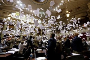 END OF SESSION: Members of the Missouri House of Representatives throw papers in the air in celebration of the end of the legislative session Friday, May 16, 2014, in Jefferson City. – Jeff Roberson/AP photo