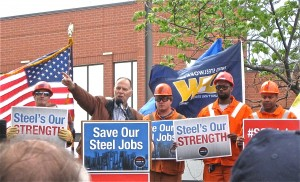 U.S. REP. BILL ENYART (D-Belleville) (pointing) gave a rousing speech in support of American products and American workers. – Labor Tribune photo