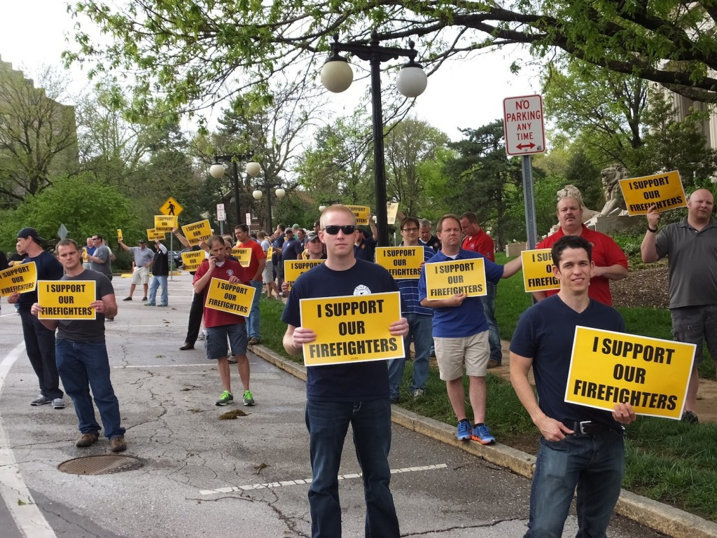 FIRED UP: Residents turned out en masse on April 28 to protest the suspension of five fire fighter members of Local 2665 with informational picketing in front of University City city hall (left) before the evening's council meeting . – Labor Tribune photo