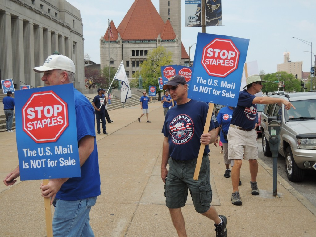 RETURN TO SENDER: Letter Carriers and Postal Workers rallied Sunday, April 27, outside the main post office in downtown St. Louis to oppose the United States Postal Service's move to outsource Postal Workers' jobs to Staples stores around the country. – Labor Tribune photo