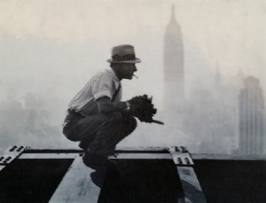 ON EDGE: Charles Ebbetts setting up the photo of ironworkers on their lunch break.  Notice the Empire State Building in the background.