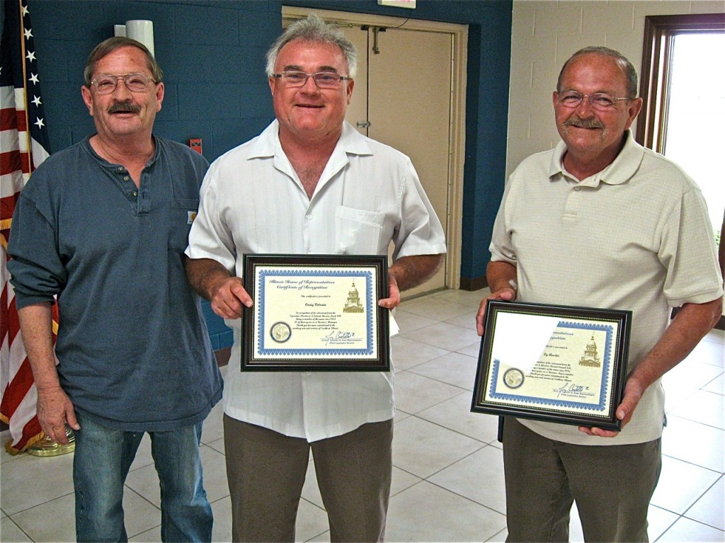THANKS FOR YOUR SERVICE: Totsie Bailey, president of the Southwestern Illinois Building and Construction Trades Council (left), presents honorary plaques to retiring Plasterers and Cement Masons Local 90 Business Manager Craig Votrian (center) and retiring Painters Local 471 Business Representative Cy Austin (right). – Labor Tribune photo