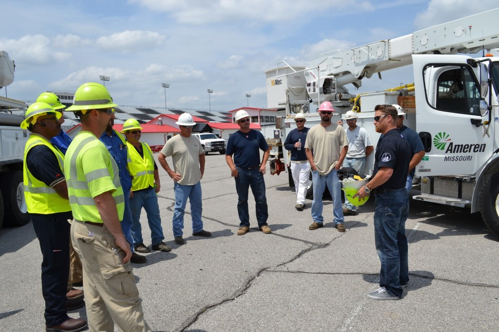 AMEREN LINE WORKERS from Missouri and Illinois meet with NASCAR driver T.J. Bell (right) at Gateway Motorsports Park on May 28. – Gateway Motorsports photo