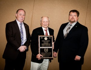 HONORED: Donald Koleson (center), an apprentice instructor for 50 years, is honored by Iron Workers Local 392 Business Manager and Financial Secretary/Treasurer Dan O'Sullivan (left) and Local 392 President and Business Agent John Herrington (right). – John Gaughn photos