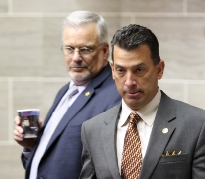 REP. KEITH ENGLISH (D-Florissant) (right) entering the House chamber to cast his vote in favor of tax cuts for the rich and economic calamity for the state budget. – Show Me Progress photo