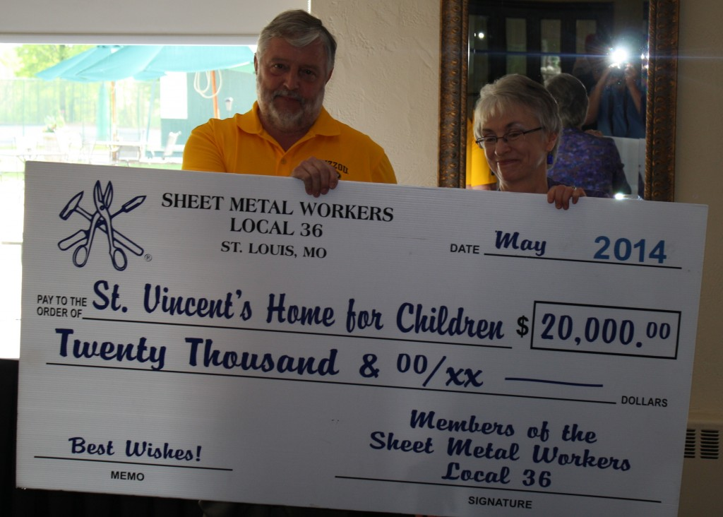 DONATION: Sheet Metal Workers Local 36 President and Business Manager David Zimmermann (left) presents a check for $20,000 to Carla Monroe-Posey, executive director of the St. Vincent's Home for Children. – Sheet Metal Workers Local 36 photos