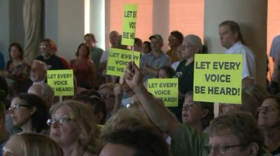 ANGRY CITIZENS made their voices heard at the University City June 16 council meeting protesting an effort by some council members to eliminate the public input sessions before the council deliberations begin, thus silencing residents' voices on controversial issues before any council action might be taken.  – Fox 2 News photo