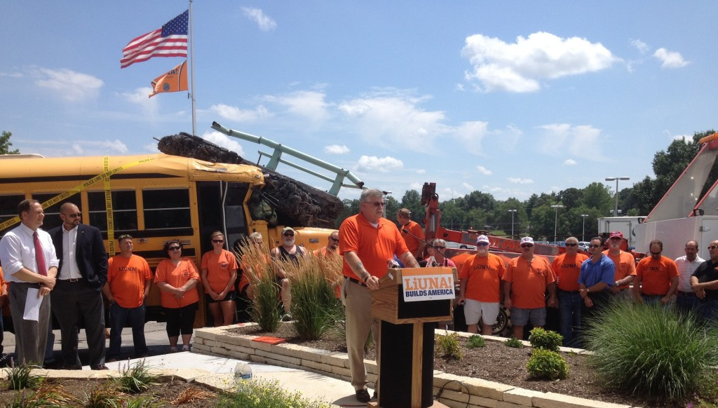 """WOULD YOU WANT YOUR KIDS ON THIS BUS?"" asked Eastern Missouri Laborers District Council Business Manager Gary Elliott at a July 14 press conference urging action on the national Highway Trust Fund and Missouri's Amendment 7 on the ballot Aug. 5.  – Labor Tribune photo"