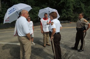 WITHIN THEIR RIGHTS: St. Louis County police captain tells IBEW Local 1 Business Manager Frank Jacobs that the union's picketing is lawful and can continue. Wright Construction Services project manager called police when Local 1 refused to stop picketing its topping out ceremony at the Lemay Aquatic Center July 9. He was told the picketing was legal.
