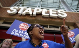 Post office employee Detra Parker chants during a recent protest outside a Staples store in Atlanta. – David Goldman/AP photo
