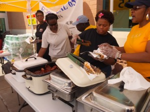 TO FIND A CURE for Sickle Cell disease UFCW Local 655 served up great BBQ at their second annual research fundraising drive July 19. Servers include Local 655 volunteers (from left) Maureen McClendon, Jan Reed, Union Representative Levi Eddins (event organizer), Demorris Taylor and Inez Broom.  Labor Tribune photos