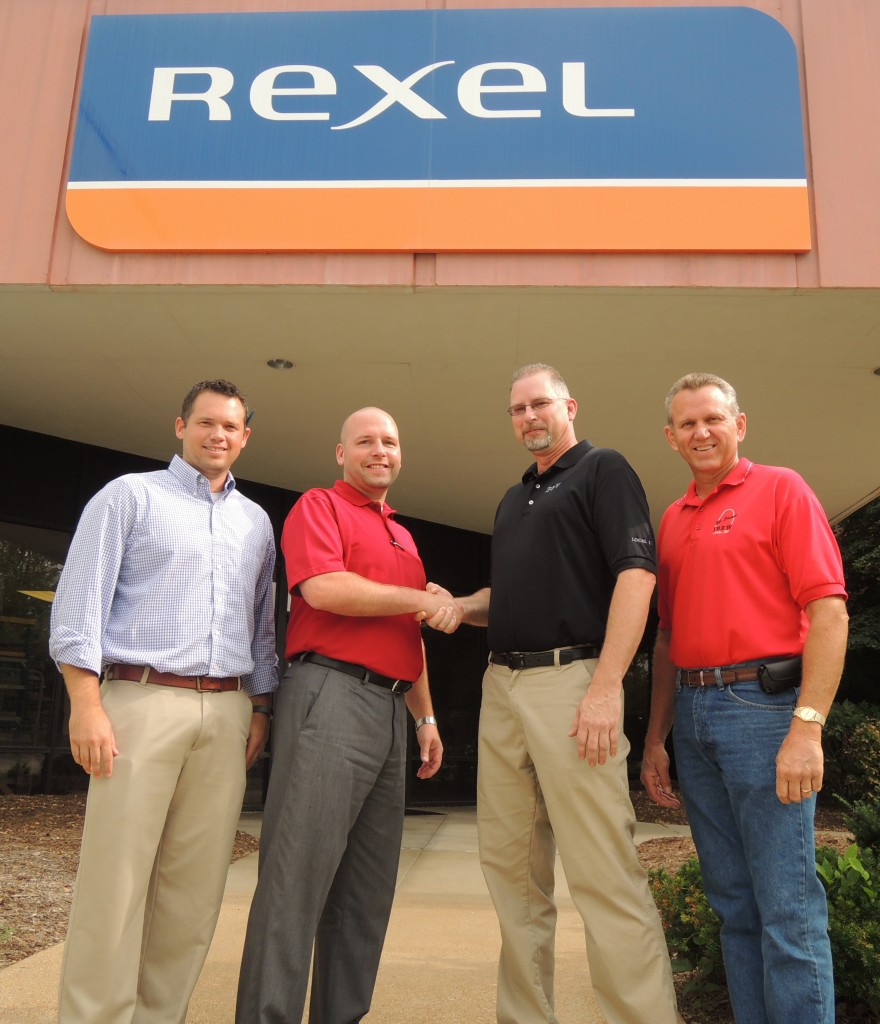 SEALING THE DEAL: Shaking on a hard-won new agreement between IBEW Local 1 and Rexel Supply are (center to right) Local 1 business representatives Chuck DeMoulin (center) and Dave Roth, with (from left) Rexel St. Louis Branch Manager Ed Rhomberg and District Manager Greg Coleman. – Labor Tribune photo