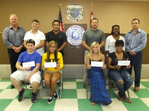 SCHOLARSHIP WINNERS of the 2014 Laborers Local 42 Larry Flinn Memorial Scholarships are (seated from left with parent standing behind) Chad Johnson (Calvin Johnson), Chloe Escobar (Carlos Escobar), Eastern Missouri Laborers' District Council scholarship winner Katelyn Louis (Jeff Louis) and An'yeal Welch (Danyeal Crittenden). At right, Local 42 Business Manager/Secretary-Treasurer Brandon Flinn; at left, Local 42 President/Field Representative Rich McLaughlin.  – Labor Tribune photo